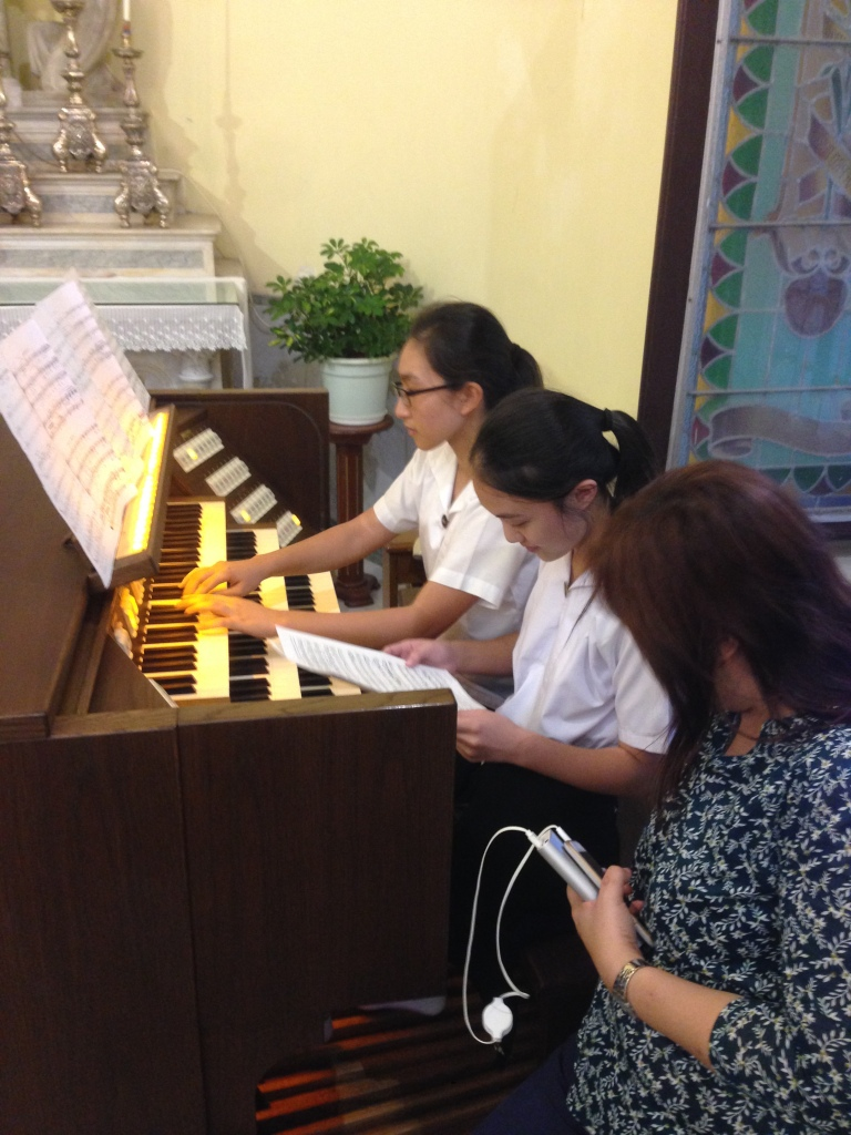 Choir pianist Samantha working with Lee Ann on the church organ in St. Lawrence.